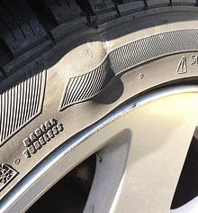 tire damaged from impact Willis Law Firm